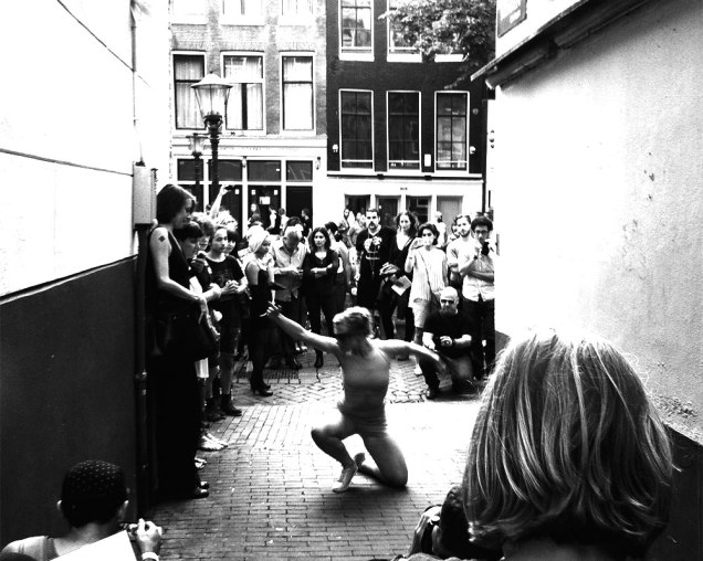 Dance performer pulling a crowd in the street